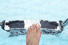 Foot and stairs of swimming pool. Foot and stairs of blue swimming pool Royalty Free Stock Image