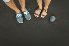 Foot stand on black sand stone. Man and woman Royalty Free Stock Photo
