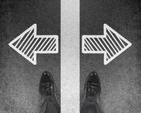 Foot standing on arrows Stock Images