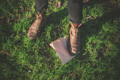 Foot standing on paper bag Royalty Free Stock Images