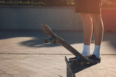 Foot standing on skateboard. Stock Image