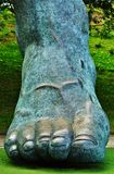 Foot. Statue in front of a soccer field stock photos