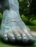 Foot. Statue in front of a soccer field stock image