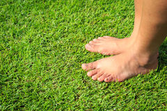 Foot step on green grass Stock Images