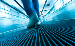 Foot step movement of abstract escalator Stock Photos