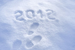 Foot step print in snow - New Year 2012 Stock Images
