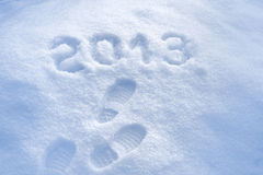 Foot step print in snow - New Year 2013 Royalty Free Stock Photos