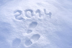 Foot step prints in snow, New Year 2014 Royalty Free Stock Image