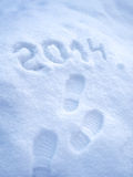 Foot step prints in snow, New Year 2014 Royalty Free Stock Images