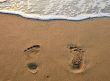 Foot step on the sand Stock Photo