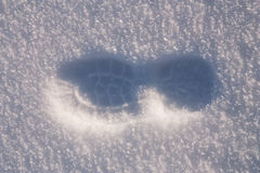 Foot step in snow Royalty Free Stock Photography