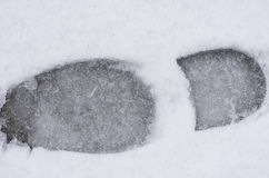 Foot step in snow Royalty Free Stock Photo