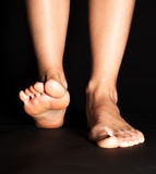 Foot stepping in black Stock Photos