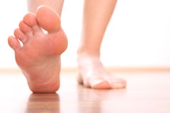 Foot stepping closeup woman legs Royalty Free Stock Photos