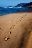 Foot steps in the sand Stock Photo