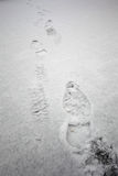 Foot steps in snow snow winter texture background Stock Images