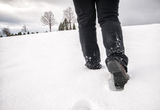 Foot steps walking at snow in winter Stock Photo
