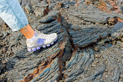 Foot on the stones of volcanic flow Royalty Free Stock Image