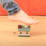Foot stretching house Royalty Free Stock Image