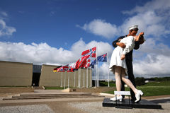 25 foot tall Unconditional Surrender statue dwarfs the Caen Memorial building in Normandy, France Stock Photos