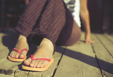 Foot in thongs Stock Photos