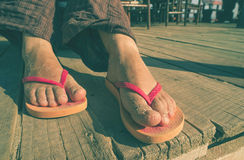 Foot in thongs Stock Photography