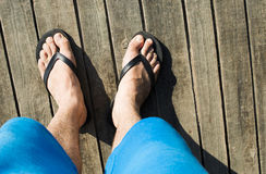 Foot in thongs Stock Images