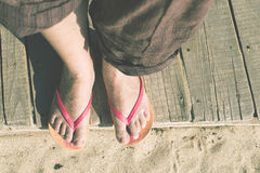 Foot in thongs Stock Photo