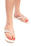 A foot in thongs. Female foot in thongs on a white background Royalty Free Stock Photos