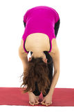 Foot to Fingers Forward Bend in Yoga royalty free stock images