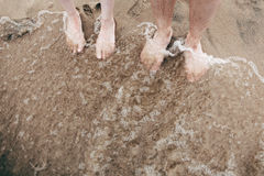 On foot to the sandy beach at high tide Royalty Free Stock Images