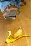 Foot about to tread on a banana skin Stock Image