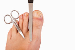 Foot with toenail fungus. Scissors and file-isolated stock images