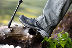Foot tourist in hiking boots. Stock Image