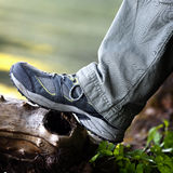 Foot tourist in hiking boots. Royalty Free Stock Photo