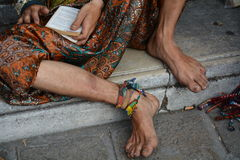 Foot of a traveller. The foot of a traveller taking a rest on the cement pavement Royalty Free Stock Image