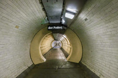 Foot tunnel at Greenwich, London, crossing under the River Thames. Old tunnel built in 1902 to cross from north to south of the River Thames and still in fulll stock image