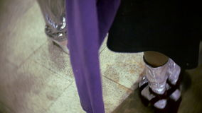 Foot two models waiting for the show at the backstage of fashion week. Tile floor and foot two models waiting for the show at the backstage of fashion week stock video