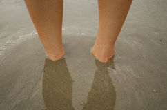 Foot under the sand. Relax and play. With the sand Royalty Free Stock Photo