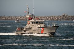 47 foot United States Coast Guard Motor Life Boat on patrol in the Tillamook Bar. 47 foot United States Coast Guard Motor Life Boat on patrol in the Tillamook Stock Image