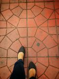 Foot walking on abstract cement street Royalty Free Stock Photos
