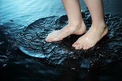 Foot in water Stock Photos