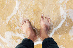 Foot in the water of the sea Royalty Free Stock Photography