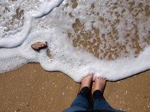 Foot wave on the beach Stock Photos