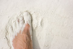Foot on white sand. Male foot standing on white sand beach Stock Photos