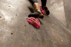 Foot of woman exercising at indoor climbing gym Royalty Free Stock Photos