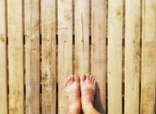 Foot on the ole wooden. royalty free stock image