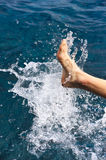 Foot of young man in water Royalty Free Stock Photography