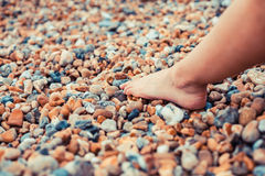The foot of a young woman on the beach Stock Photography