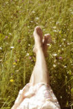 Foot of a young woman lying on sunny Royalty Free Stock Images